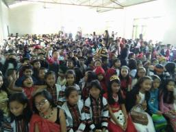 The school hall packed with excited children