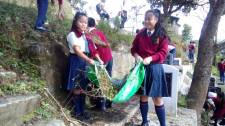 Girls collecting waste
